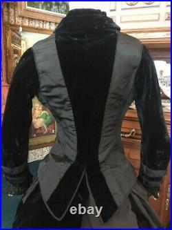 #21-095, Elegant 1870's 2pc Black Silk and Navy Velvet Bustle Gown Fan Pocket